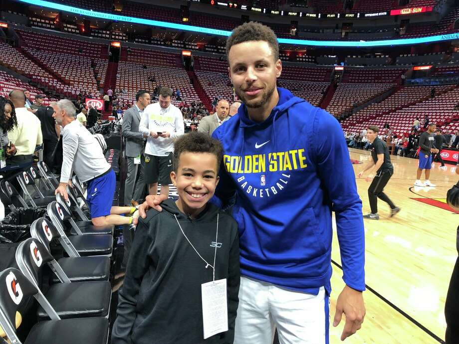 Malichi Sims, 11, met his hero Stephen Curry after a video of him crying while receiving Warriors tickets went viral. Photo: Charles Hinkle/Courtesy