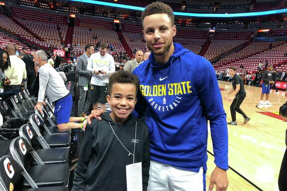Malichi Sims, 11, met his hero Stephen Curry after a video of him crying while receiving Warriors tickets went viral.