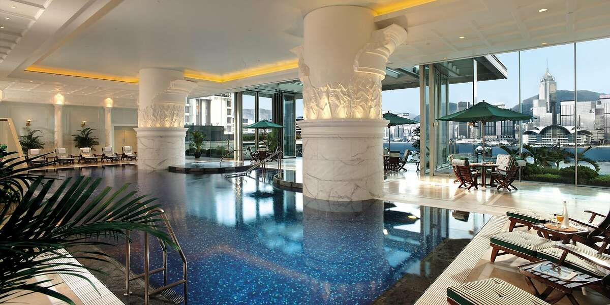 The large Roman-style swimming pool at the Peninsula Hong Kong offers impressive views across the harbor.