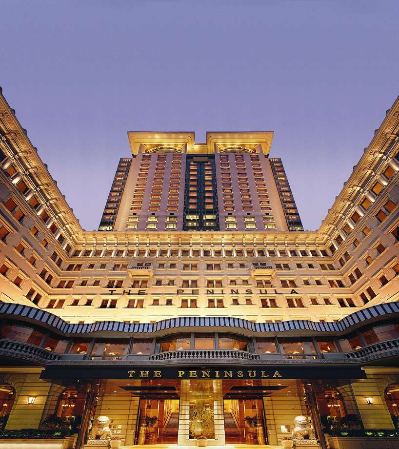 Built in 1994, the 30-story tower of the Peninsula Hong Kong rises behind the original 1928 building. Photo: The Peninsula Hong Kong