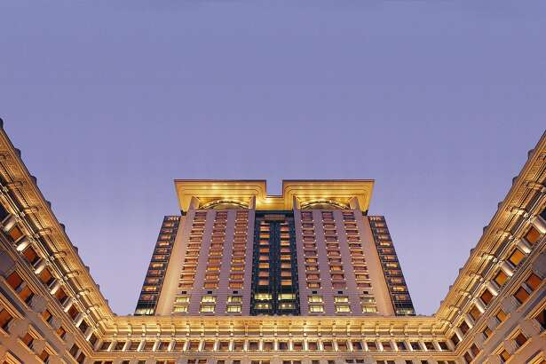Built in 1994, the 30-story tower of the Peninsula Hong Kong rises behind the original 1928 building .