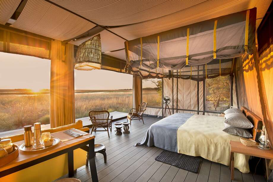 Zambia's Liuwa Plain National Park now offers a permanent safari camp, the eco-luxury King Lewanika Lodge, top and above. Left: Elephants are common in Botswana's Okavango Delta, where Wilderness Safaris' Qorokwe Camp opens this month. Photo: Courtesy Time + Tide