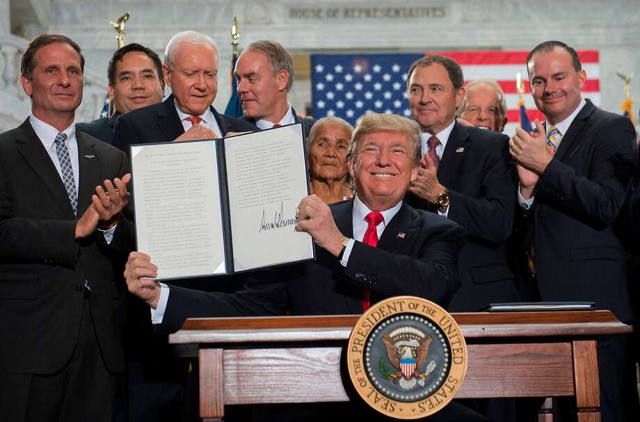 President Trump holds his decree shrinking Bears Ears and Grand Staircase-Escalante national monuments at the state Capitol in Salt Lake City. Conservationists slammed the move. Photo: SAUL LOEB, AFP/Getty Images