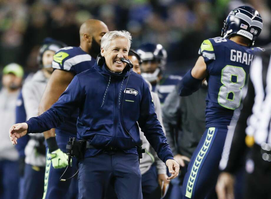 SEATTLE, WA - DECEMBER 03: Seattle Seahawks head coach Pete Carroll greets Jimmy Graham #88 after his touchdown in the first quarter against the Philadelphia Eagles at CenturyLink Field on December 3, 2017 in Seattle, Washington. (Photo by Otto Greule Jr /Getty Images) Photo: Otto Greule Jr/Getty Images