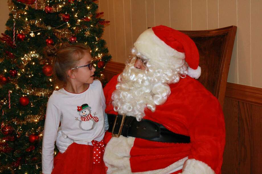 Area children had an opportunity to meet the big guy from up north, Santa, on Saturday at the Caseville Eagles Club. Photo: Rich Harp/For The Tribune