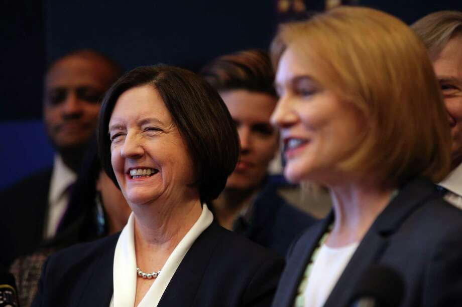 Seattle mayor Jenny Durkan announces the search for a new Chief of Police as Kathleen O'Toole, left, steps down from the position she has held for three and a half years, December 4, 2017 at City Hall. Photo: GENNA MARTIN, SEATTLEPI / SEATTLEPI