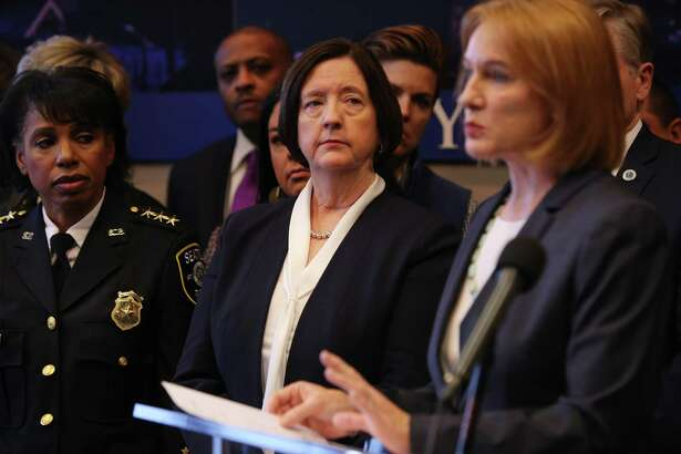 Seattle mayor Jenny Durkan announces the search for a new Chief of Police as Kathleen O'Toole, center, steps down from the position she has held for three and a half years, December 4, 2017 at City Hall. Deputy Chief Carmen Best, left, will become interim chief beginning January 1.