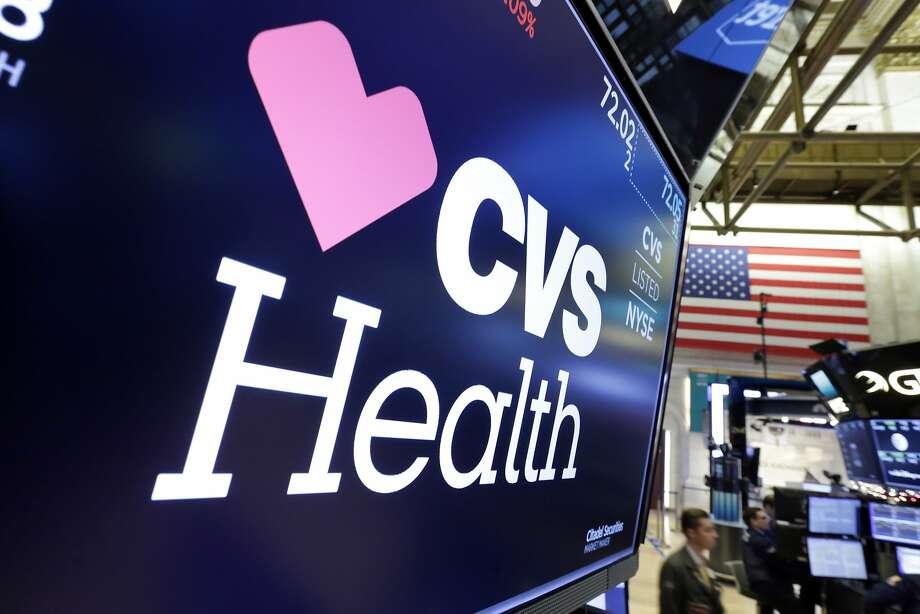 The CVS Health logo appears above a trading post on the floor of the New York Stock Exchange. Photo: Richard Drew, Associated Press