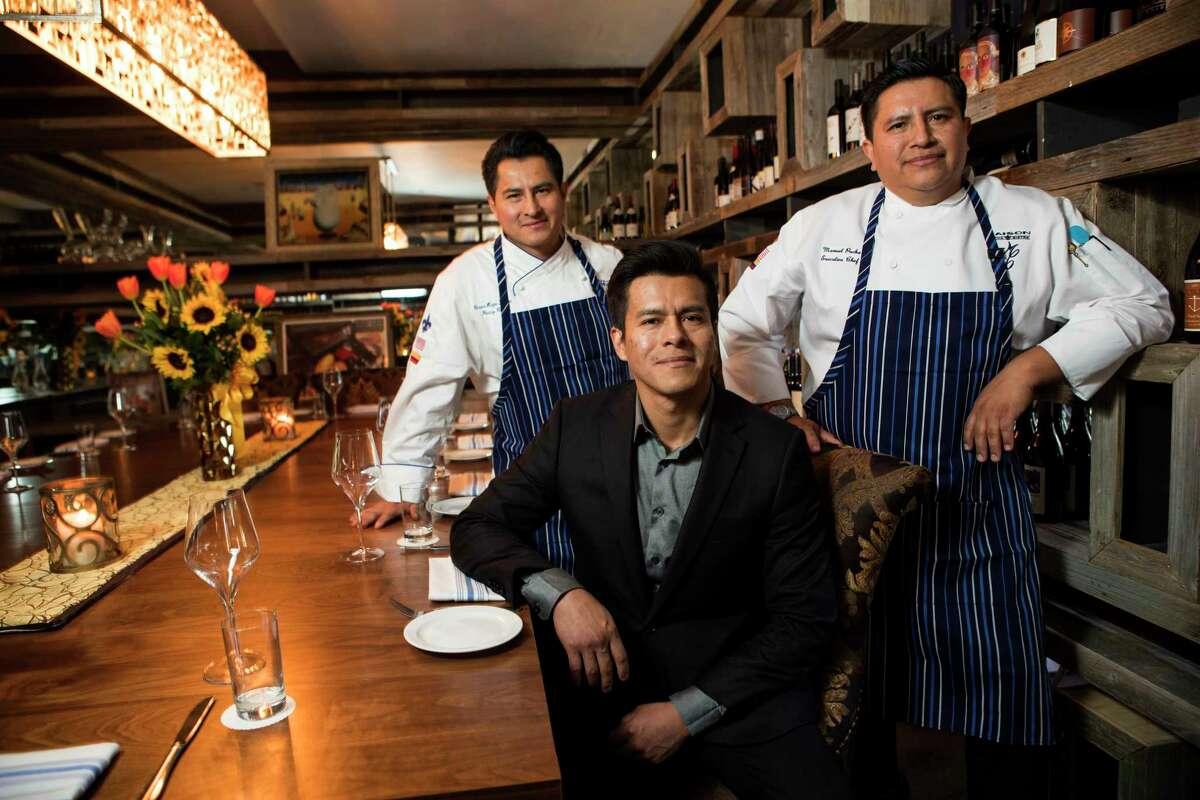 Victor Pucha, pastry chef, left, Cristian Pucha, sommelier, center, and Manuel Pucha, executive chef, pose for a portrait in the wine room at Maison Pucha Bistro on Friday, Nov. 24, 2017, in Houston. ( Brett Coomer / Houston Chronicle )