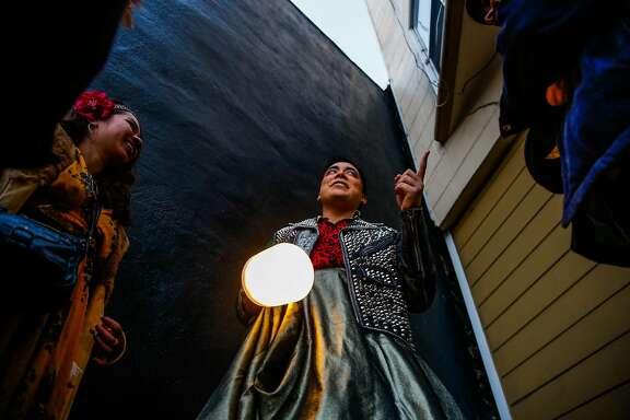 "Kevin Lopez leads a walking tour as part of the Detour Dance piece ""Fugue"" in San Francisco, Calif., on Sunday, Dec. 3, 2017."