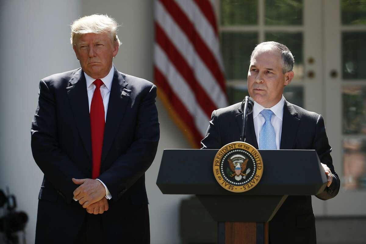 President Donald Trump listens as EPA Administrator Scott Pruitt speaks onJune 1, 2017.