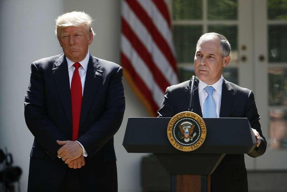 President Donald Trump listens as EPA Administrator Scott Pruitt speaks onJune 1, 2017. Photo: Pablo Martinez Monsivais, Associated Press