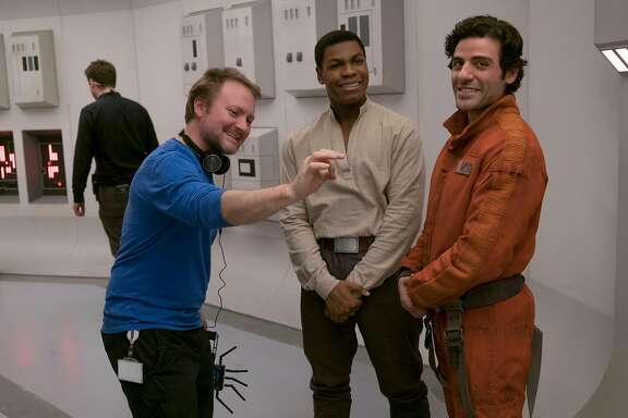 """The Last Jedi"" director Rian Johnson, left, on set with stars John Boyega and Oscar Isaac.  Credit: Lucasfilm/Disney"