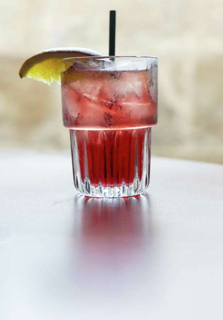 Turkey Cranberry cocktail, a simple drink served at the On the Rocks bar that uses Wild Turkey bourbon and cranberry-flavored Red Bull. Photo: William Luther /San Antonio Express-News / © 2017 William Luther