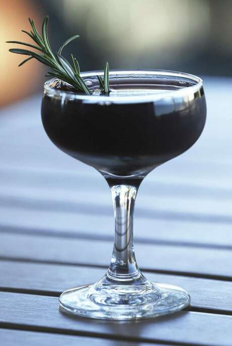 The Red Rider cocktail at Bar 301 in Leon Springs includes rye whiskey, black strap rum and mulled red wine. Photo: Tom Reel /San Antonio Express-News / 2017 SAN ANTONIO EXPRESS-NEWS
