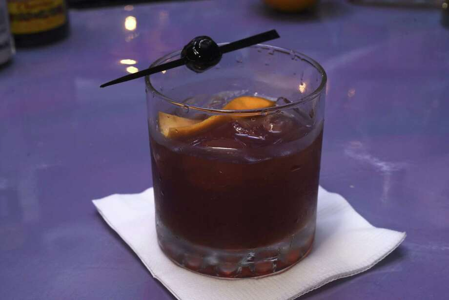 A Smoky Old Fashioned, served at the Breathe Lounge at 8800 Broadway, blends two varieties of bitters with locally made whiskey. Photo: Billy Calzada /San Antonio Express-News