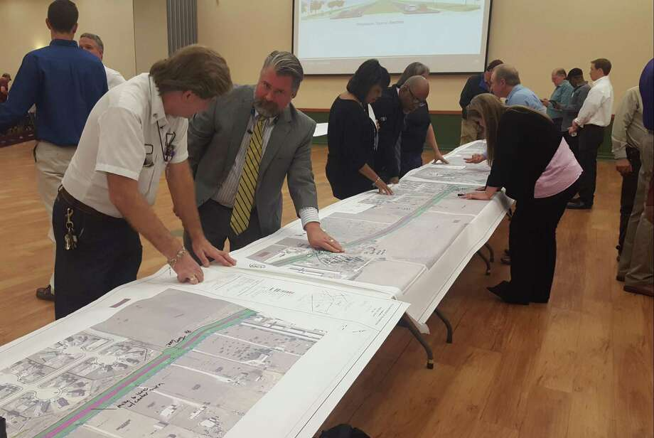 Schertz businessman and resident Tim Knotts (left) discusses concerns about the proposed widening of FM 1518 with Mayor Michael Carpenter during the Nov. 29 Texas Department of Transportation FM 1518 project open house at the Schertz Civic Center. Photo: Jeff B. Flinn / Northeast Herald /Northeast Herald