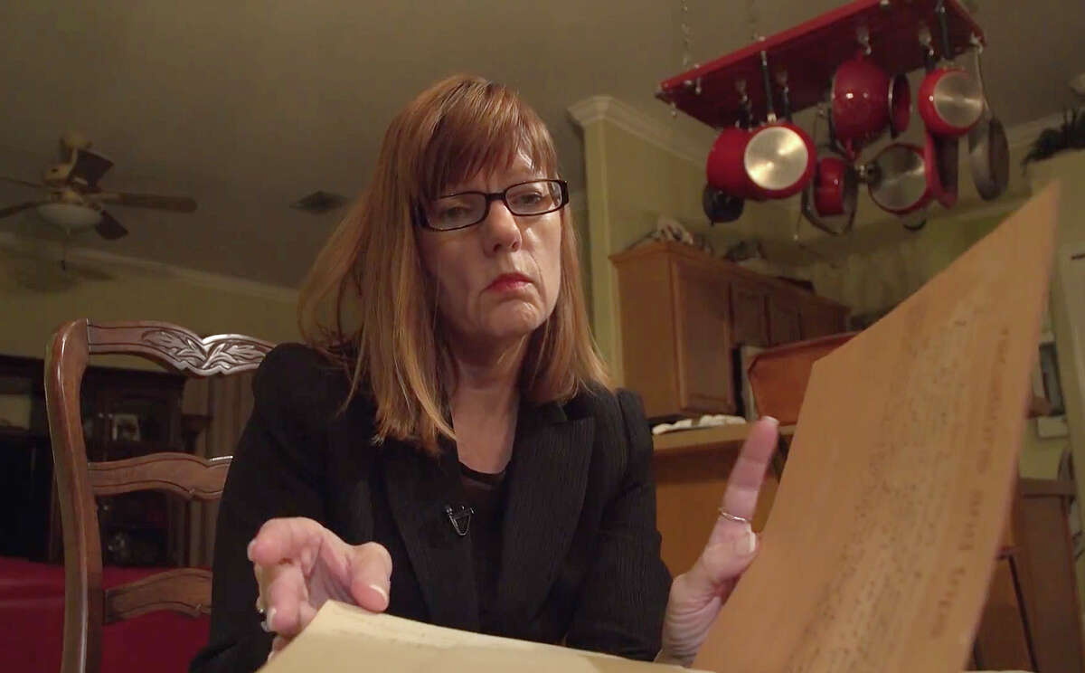 Debbie Wesson Gibson looks through a scrapbook from her senior year in high school, where several pages include what she says is evidence of her relationship with Roy Moore when she was 17 and he was 34.