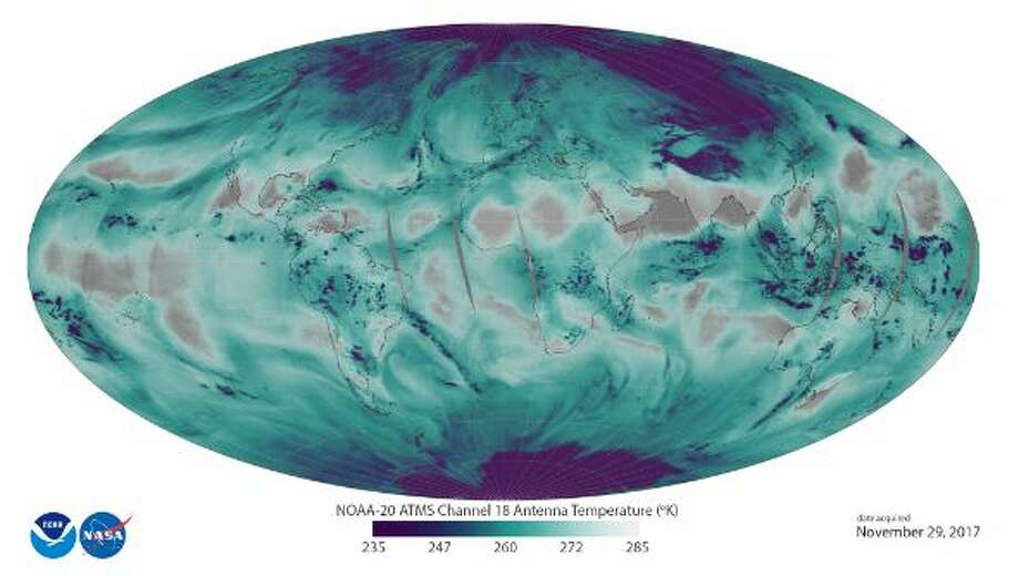 """This image uses ATMS data to depict the location and abundance of water vapor (as associated with antenna temperatures) in the lower atmosphere, from the surface of the Earth  to 5 kilometers altitude. Transparent/grey colors depict areas with less water vapor, while blue-green and purple colors represent abundant water in all phases (vapor, clouds, and precipitation) in low and middle latitudes. In the polar regions, purple depicts surface snow and ice."" -NOAA Photo: NOAA"
