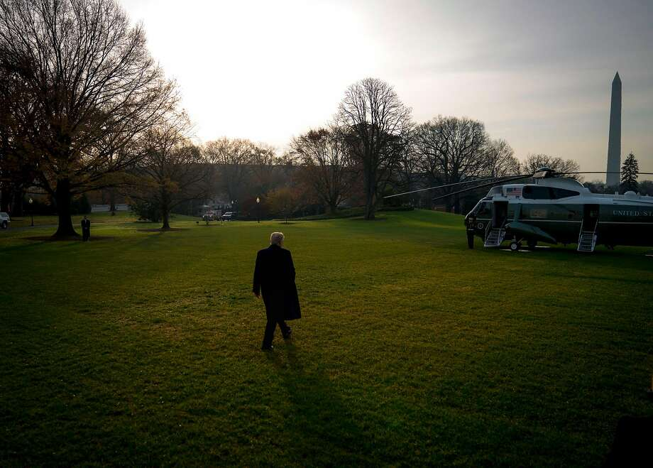 President Trump walks toward Marine One on the White House grounds as he departs for Utah after complaining the FBI ruined the life of Michael Flynn, his former national security adviser who has pleaded guilty to lying to the FBI. Photo: DOUG MILLS, NYT