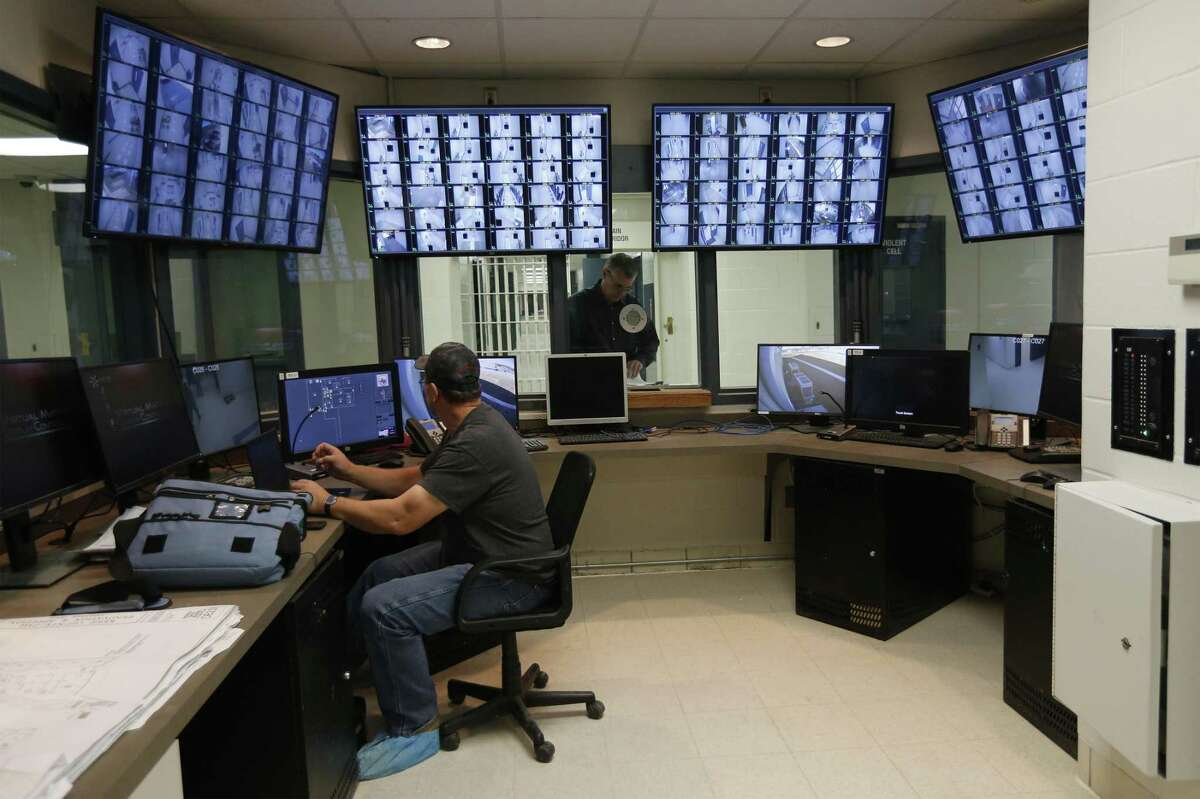 Final touches are done in the control room where additional monitors are added for the expanded monitors at the Kerr County Jail on Wednesday, Nov. 29, 2017. Kerr County Sheriff Rusty Hierholzer said the jail expanded from 192 beds to 328 beds at the facility. Through a $15,000,000 million bond, the county jail which was built in 1995 underwent a renovation and an expansion. (Kin Man Hui/San Antonio Express-News)