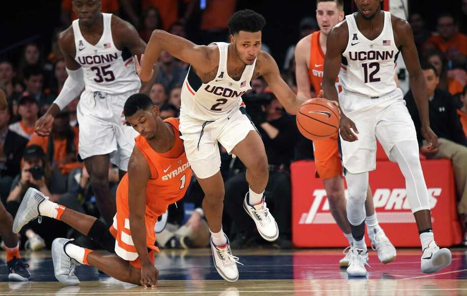 UConn's Jalen Adams (2) pushes the ball up the floor during last season's matchup against Syracuse at Madison Square Garden. Photo: Brad Horrigan / Hartford Courant / Hartford Courant
