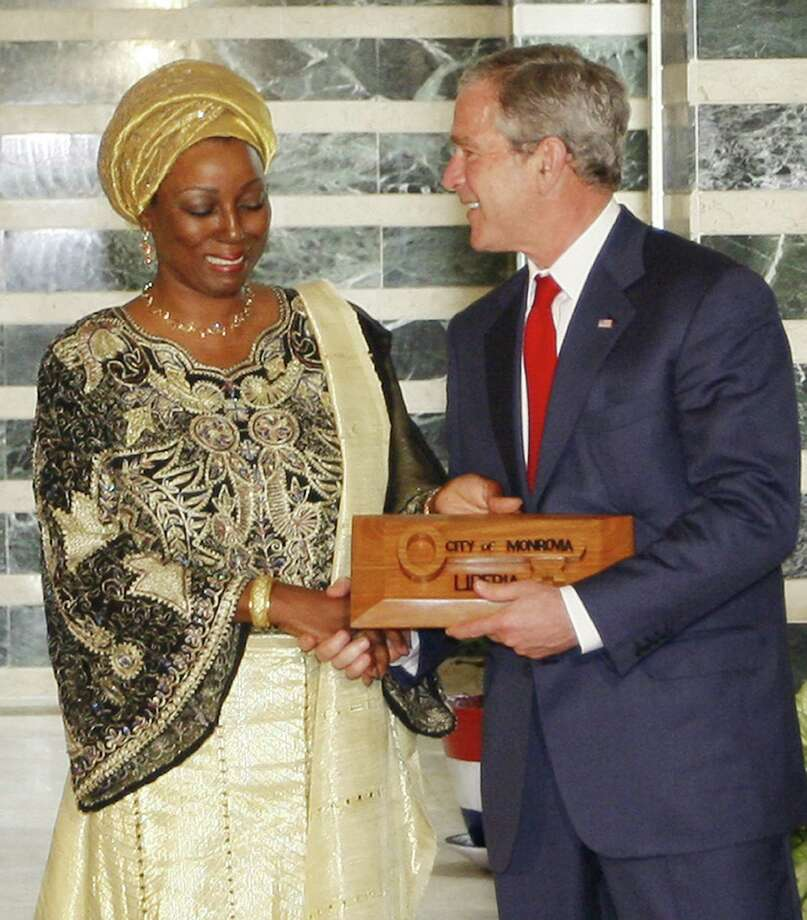 President George W. Bush receives the key to the city from Mayor Ophelia Hoss-Saytumah in Monrovia, Liberia in 2008. Under his administration, the U.S. began a massive funding campaign in Africa to attack AIDS. It has been wildly successful, but if threatened with funding cuts by the Trump administration. Photo: Charles Dharapak /AP / AP