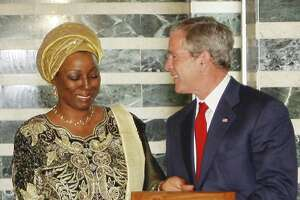 President George W. Bush receives the key to the city from Mayor Ophelia Hoss-Saytumah in Monrovia, Liberia in 2008. Under his administration, the U.S. began a massive funding campaign in Africa to attack AIDS. It has been wildly successful, but if threatened with funding cuts by the Trump administration.