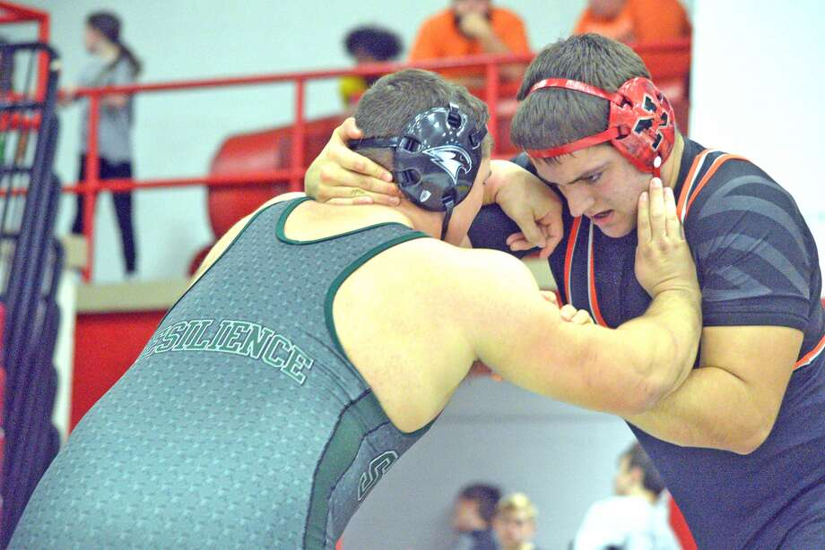 Edwardsville junior Josh Anderson, right, wrestles Staley's Marwan Kirkwood on Saturday during the third-place meet against Staley in the Ron Sauer Duals at Fox High School in Arnold, Mo.