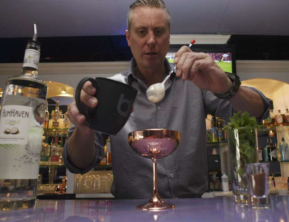 James English of Breathe Lounge on Broadway prepares an Espresso Warmer cocktail, which mixes espresso with a blend of liqueurs. Photo: Billy Calzada /San Antonio Express-News