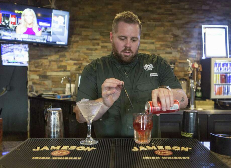 "On the Rocks owner Justin Vitek, seen here mixing a cocktail in late 2017, didn't take kindly to a TV makeover offer by a woman who Id'd herself as a casting director for Paramount Network show ""Bar Rescue,"" which heads into its sixth TV season this year. Photo: William Luther /San Antonio Express-News / © 2017 William Luther"