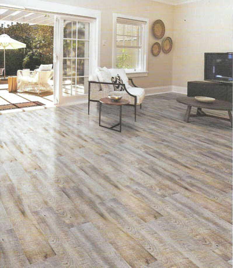 This vinyl flooring captures the rich look of real wood, right down to  the texture. But it's low maintenance, long-wearing vinyl instead. See  the Southwind collection at Southwest Floors, 1113 Andrews Highway, this  week. Photo: Courtesy Photo