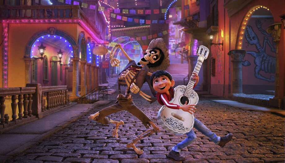 """In this image released by Disney-Pixar, character Hector, voiced by Gael Garcia Bernal, left, and Miguel, voiced by Anthony Gonzalez, appear in a scene from the animated film, """"Coco."""" (Disney-Pixar via AP) Photo: Pixar, HONS / Associated Press / © 2017 Disney•Pixar. All Rights Reserved."""