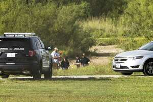 Authorities assess the scene where a deceased person was found on Dec. 2, 2017, at Cheyenne Park.