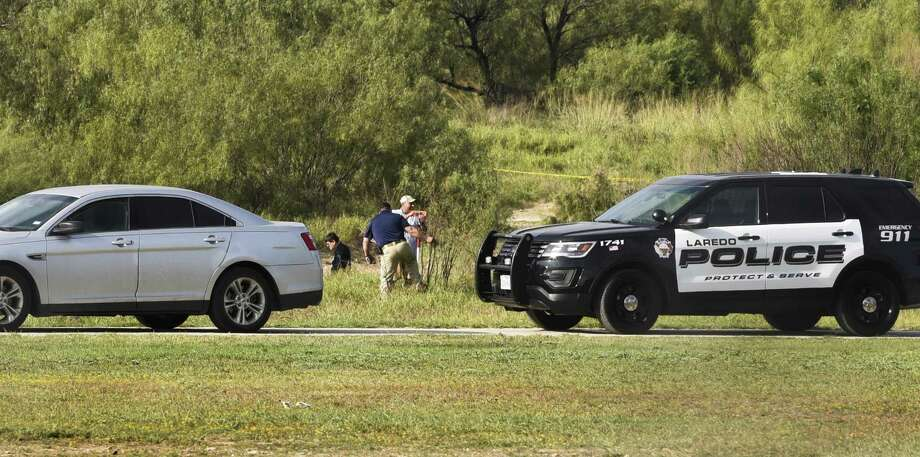 Authorities assess the scene where a deceased person was found on Dec. 2, 2017, at Cheyenne Park. Photo: Danny Zaragoza, Staff Photographer / Laredo Morning Times / Laredo Morning Times