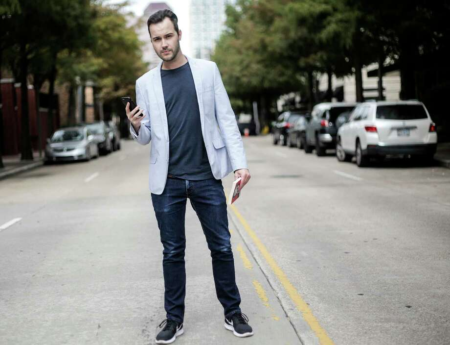 Jef Van Der Avoort, co-founder of Squirl, poses for a photo in Houston on Tuesday, Nov. 21, 2017. The mobile app uses GPS to call up books set in the same location as the user. ( Elizabeth Conley / Houston Chronicle ) Photo: Elizabeth Conley, Chronicle / © 2017 Houston Chronicle