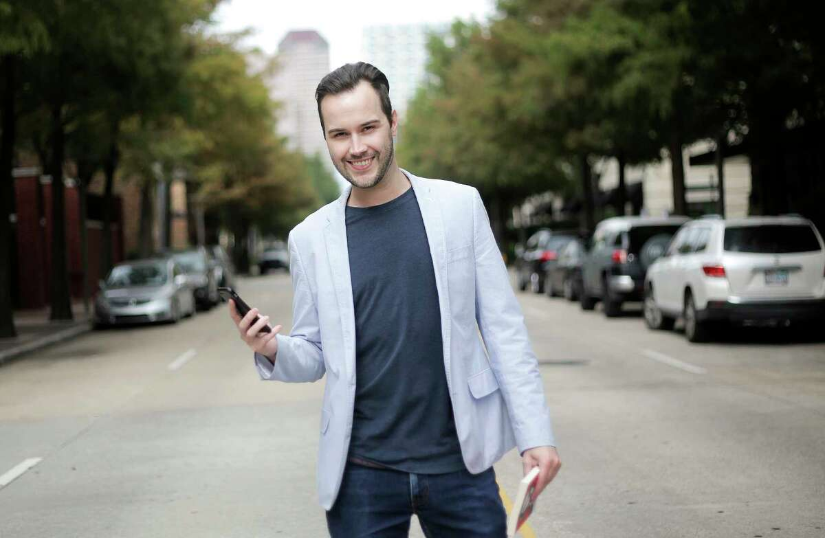 Jef Van Der Avoort, co-founder of Squirl, poses for a photo in Houston on Tuesday, Nov. 21, 2017. The mobile app uses GPS to call up books set in the same location as the user. ( Elizabeth Conley / Houston Chronicle )