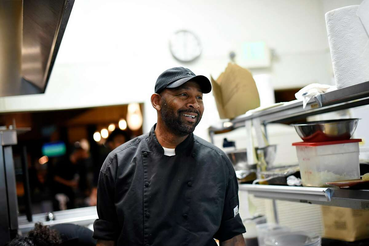 Owner Nigel Jones jokes with his staff as he works in the kitchen of his restaurant Kingston 11, in Oakland, CA, on Thursday November 30, 2017.