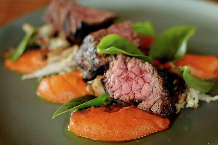 The Bavette Steak with romesco, Napa cabbage and oyster mushroom slaw and radish chimichurri at Presidio