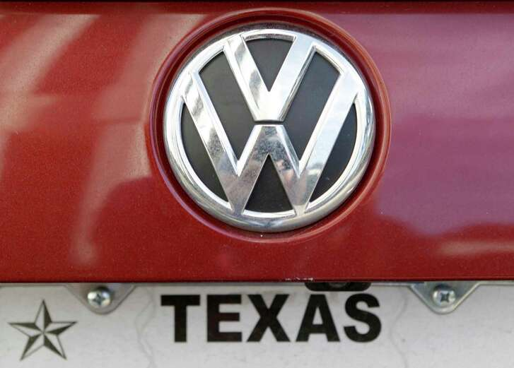 The VW symbol is shown on a 2015 Volkswagen Passat owned by Donna Knowles on Oct. 21, 2015, in Houston. She sued the German automaker because of the emissions problems.