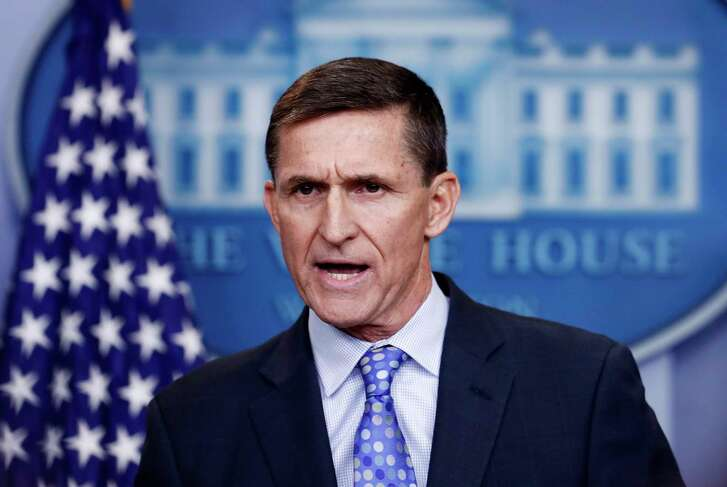 """CORRECTS MICHAEL FLYNN WAS FIRED AND NOT DONALD TRUMP - FILE - In this Feb. 1, 2017 file photo, National Security Adviser Michael Flynn speaks during the daily news briefing at the White House, in Washington. Court documents released Friday revealed that Flynn planned to plead guilty to a single count of """"knowingly and willingly"""" making false statements to the FBI during his short stint as Trump's national security adviser. Flynn was fired last February after he misled Vice President Mike Pence and other senior officials about his contacts with Russian intermediaries. (AP Photo/Carolyn Kaster)"""
