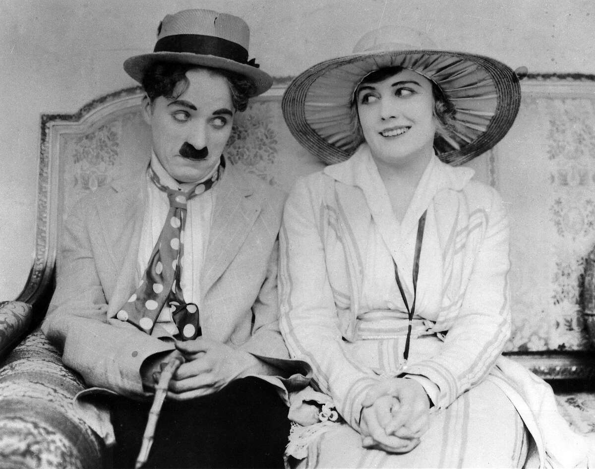 Charles Chaplin and Edna Purviance in