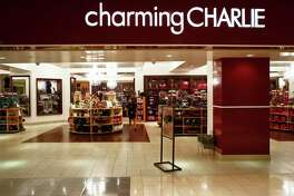 Charming Charlie, a retail chain that sells trendy, affordable jewelry and accessories in his Galleria mall, Wednesday, Nov. 30, 2011, in Houston.   The company has gone through a major wave of expansion, making a name for itself with many of its jewelry pieces selling for $14.95. The merchandise is grouped by color and by trend, so the stores are easy to navigate.   ( Michael Paulsen / Houston Chronicle )