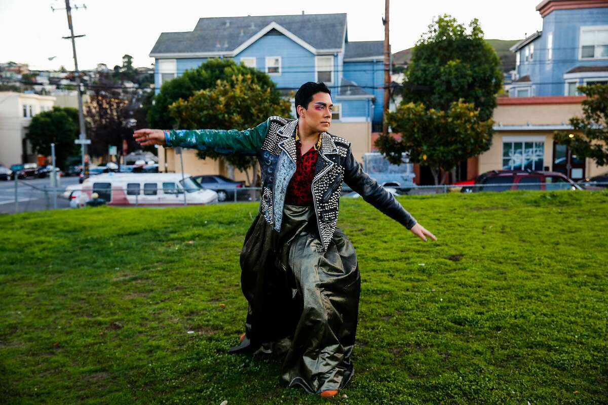 Kevin Lopez dances while leading a walking tour during the first part of the Detour Dance piece