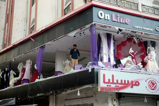 A man inspects his store Monday near the residence of Yemen's former President Ali Abdullah Saleh in Sanaa, Yemen. Saleh was killed within hours of an explosion at his family's compound.