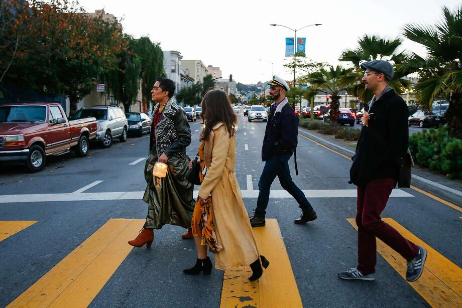 """Kevin Lopez (left) leads Kat Cole, Eric Garcia and John Hill across the street while on a walking tour as part of the Detour Dance piece """"Fugue."""" Photo: Gabrielle Lurie, The Chronicle"""