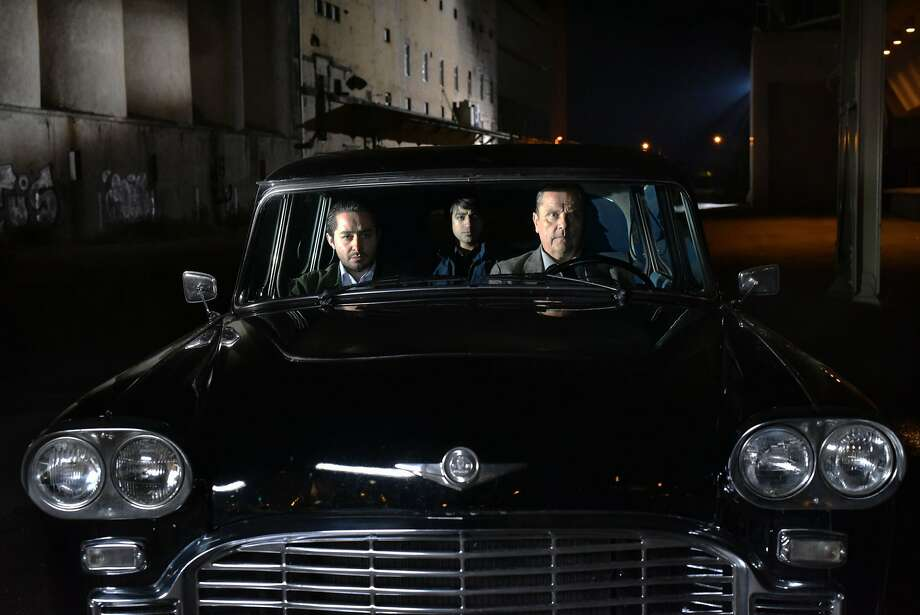 "Sherwan Haji (left), Simon Al-Bazoon  and Sakari Kuosmanen star in Finnish writer/director Aki Kaurismäki's ""The Other Side of Hope,"" a tale about an unlikely friendship. Photo: Janus Films"