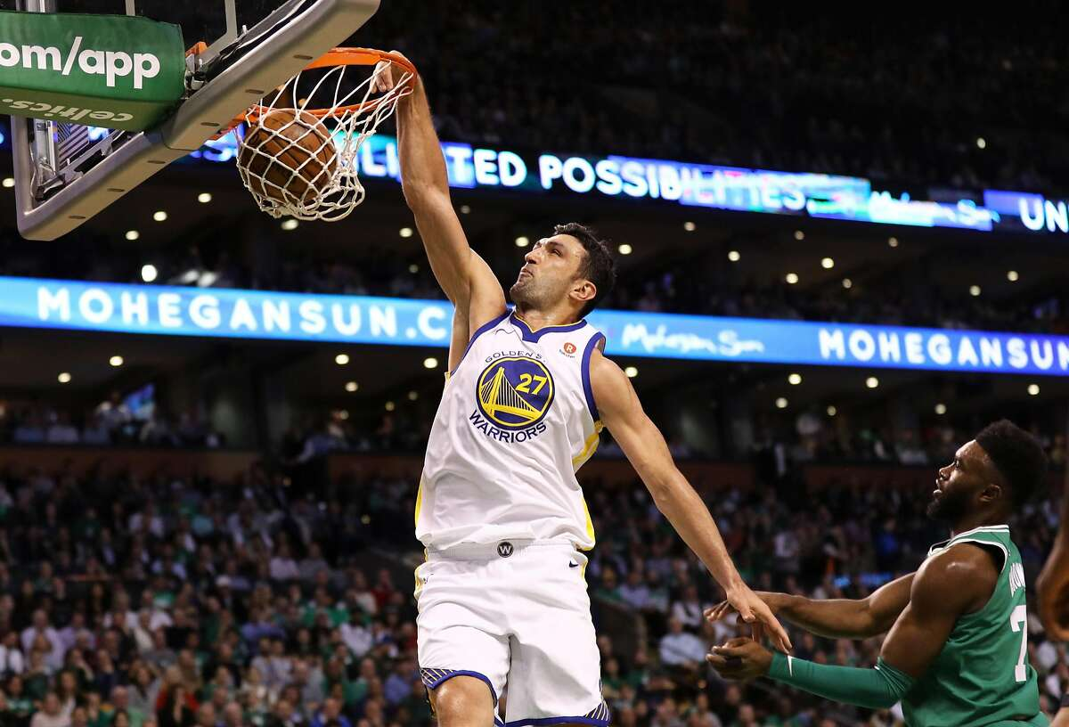 BOSTON, MA - NOVEMBER 16: Zaza Pachulia #27 of the Golden State Warriors dunks against Jaylen Brown #7 of the Boston Celtics during the first quarter at TD Garden on November 16, 2017 in Boston, Massachusetts. (Photo by Maddie Meyer/Getty Images)
