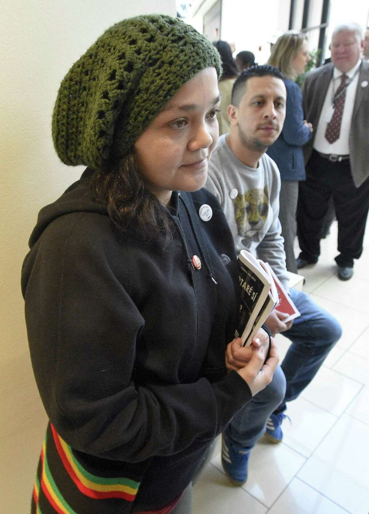 Lupe Martinez of Stamford talks with the media following a rally at the Hilton Stamford Hotel & Executive Meeting Center on Friday, Dec. 1, 2017 in Stamford, Connecticut. Martinez, who works as a Banquet Server and husband Irwin Martinez, a cook, joined with co-workers, city and state officials in support of employees unionizing, a measure that passed on Monday.