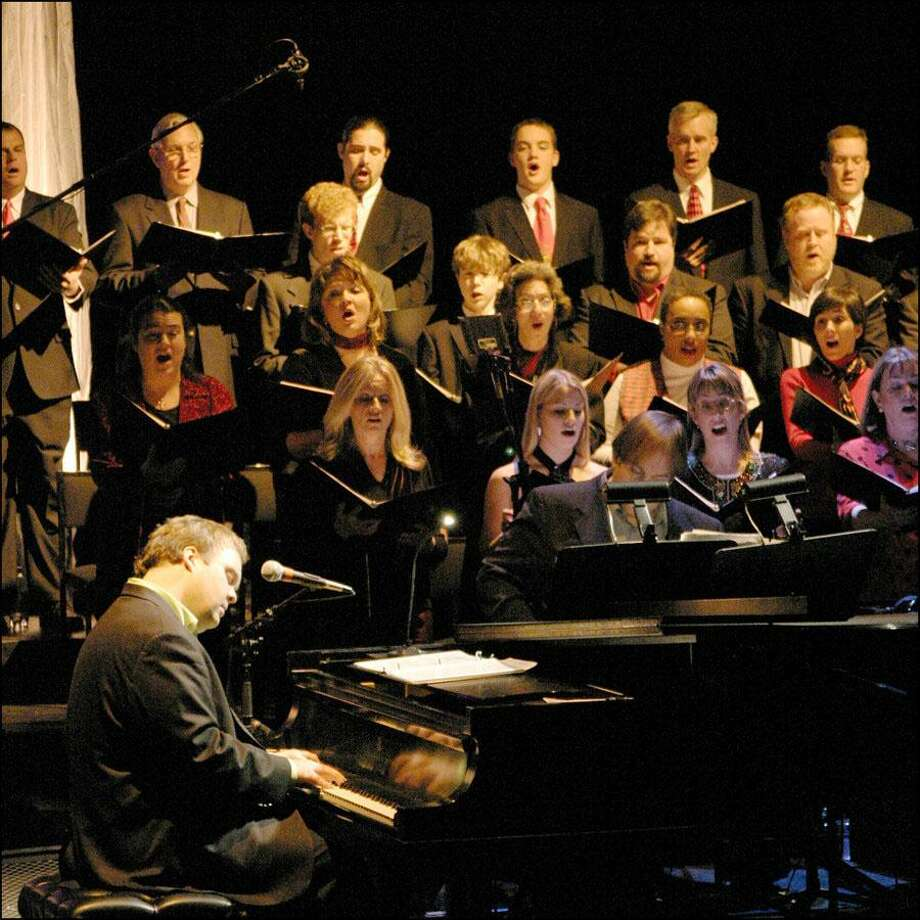 Greenwich resident Rob Mathes performs with a choir at Purchase College's Performing Arts Center, where here returns this month with his annual holiday concerts. Photo: Contributed Photo